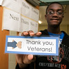 Samoset Middle School eighth grader Junior Brevette, 14, shows off the bookmarks that the school was giving out to all the veterans that showed up to their veterans lunch. SENTINEL & ENTERPRISE/JOHN LOVE