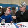 Samoset Middle School sixth grader Kyra Kittredge, 11, chats with her grandfather U.S. Army Sgt. Dolphe Richard during the veterans lunch at the school on Thursday. SENTINEL & ENTERPRISE/JOHN LOVE