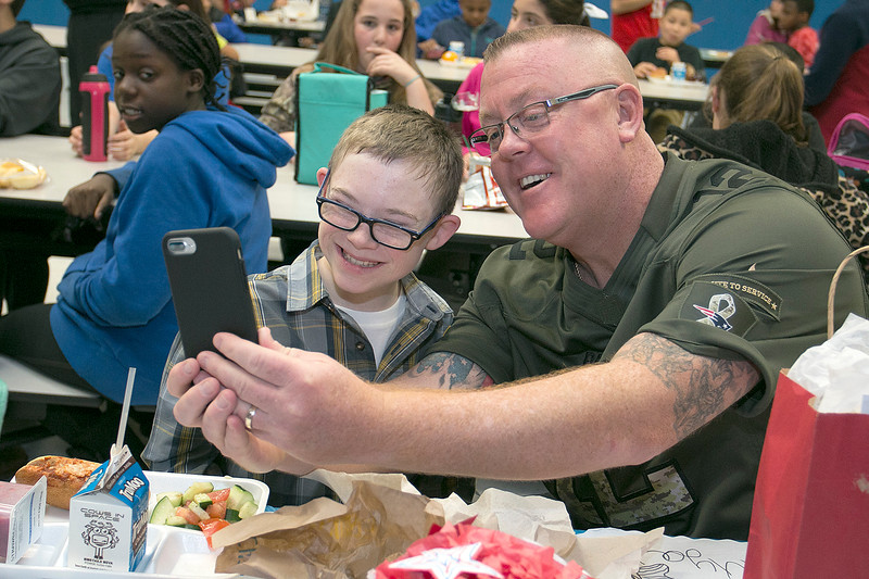 Marine veteran Lance Corporal Todd Deacon takes a selfie with his best friend Samoset Middle School student sixth grader Joe Liddy during the school's lunch with a veteran on Thursday. SENTINEL & ENTERPRISE/JOHN LOVE
