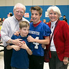 Army veteran First LT. Bill Cooper and his wife Cathy Cooper pose for a picture with Ryan Aiesi, 14, and Justin Aiesi, 12, during the Samoset Middle School veterans Lunch on Thursday. SENTINEL & ENTERPRISE/JOHN LOVE