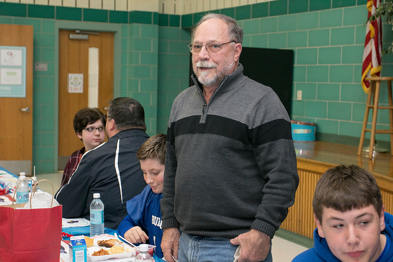 Veteran of the Navy Builder 2nd Class John Petricca stands as the Samoset Middle School Choir sang the Navy Hymn of the Armed Force Medley during the veterans lunch on Thursday at the school. SENTINEL & ENTERPRISE/JOHN LOVE