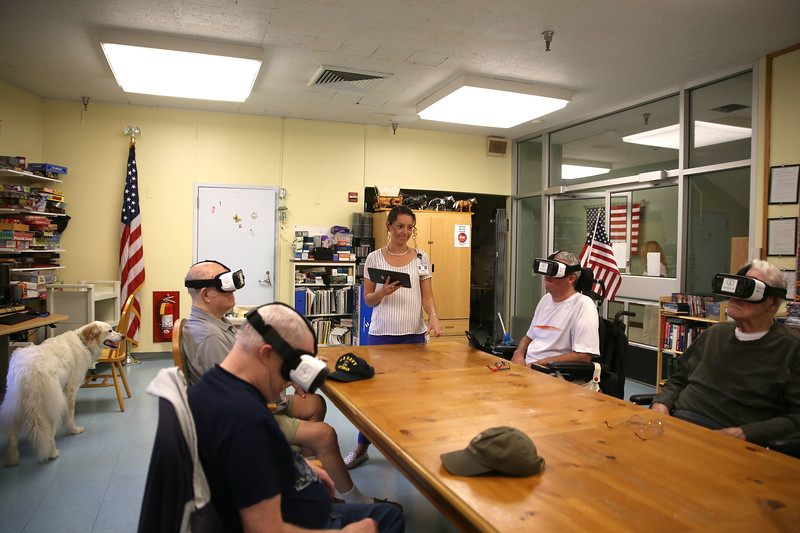 HOLLY PELCZYNSKI - BENNINGTON BANNER Activities Aid Michelle Hunt leads veteran residents through some mobility training videos through the virtual reality headsets. from left to right Navy Veteran Ray Meaney, Army veteran Kevin Kendrick, Air Force Veteran Rodney Day, and Navy Veteran Sidney Moss
