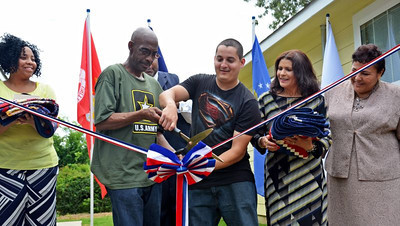 Once-homeless veteran homeowner partners Larry Linear and Miguel Guigni cut the ribbon on their new homes in Shreveport on June 1, 2013.