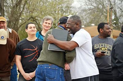 Lee Jeter, right, hugs veteran William Hardy.