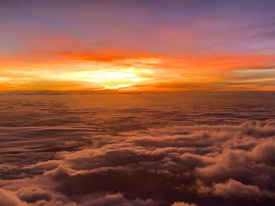 Sunrise while fying over India