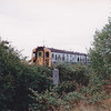 A nice framed by the bushes shot of 4TC 8031 on the approach siding into the yard on 29th July 1990