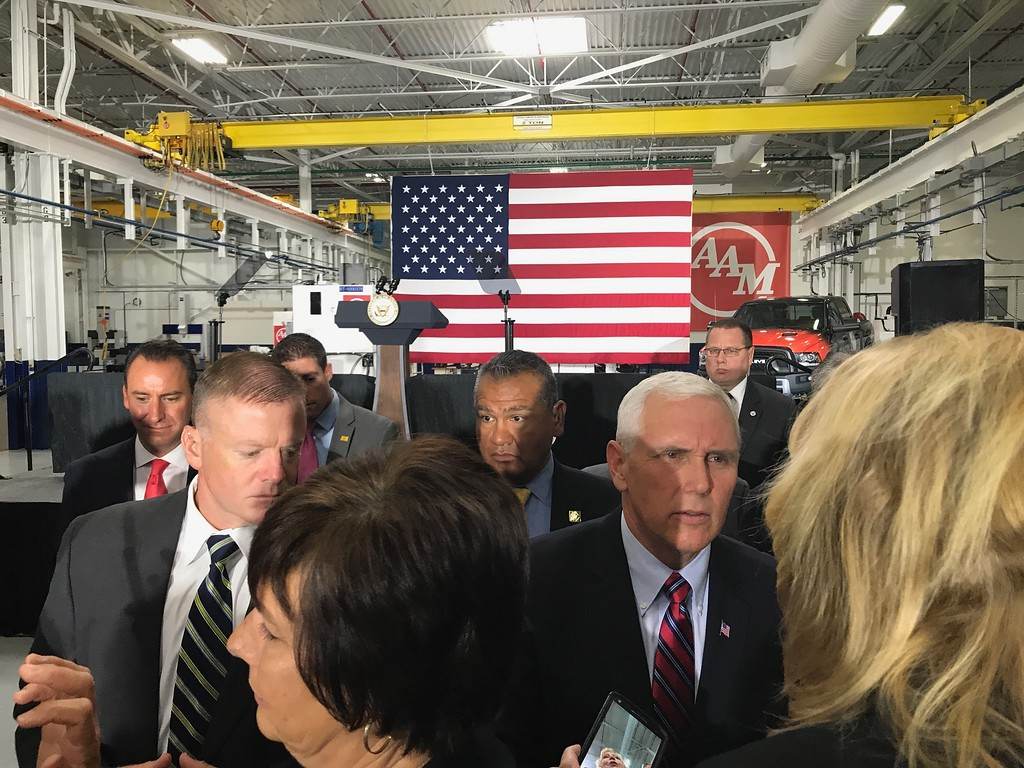 . Vice President Mike Pence speaks with a woman following remarks made at American Axle and Manufacturing in Auburn Hills, Mich., on Thursday, Sep. 28, 2017. Pence spoke about the tax reform proposal developed by the Trump Administration and the House Ways and Means Committee and the Senate Finance Committee. (Mark Cavitt/The Oakland Press)