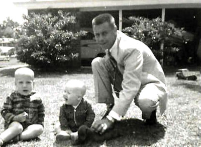 "This picture was taken shortly before my daddy died in a fluke plane crash in France.  Brother Billy on the left was 3 & JB was just a year & 4 days when he died.  & that's Bruno - the world's BEST dog!!!  (amazing how life gives us ""Signs""!  I was writing this while processing a bunch of stuff that has come up around his death 50 years ago & I JUST realized, in my arms at THIS moment is one of the 8 dogs I'm Dog Sitting - a red-ish dachshund - is buried under my arm pit & looking up at me.  WOW!!!  How OFTEN does that happen - when we don't even ""see"" the signs of how ""CONNECTED"" we are that we get!!!???)"