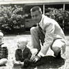 """This picture was taken shortly before my daddy died in a fluke plane crash in France.  Brother Billy on the left was 3 & JB was just a year & 4 days when he died.  & that's Bruno - the world's BEST dog!!!<br /> <br /> (amazing how life gives us """"Signs""""!  I was writing this while processing a bunch of stuff that has come up around his death 50 years ago & I JUST realized, in my arms at THIS moment is one of the 8 dogs I'm Dog Sitting - a red-ish dachshund - is buried under my arm pit & looking up at me.  WOW!!!  How OFTEN does that happen - when we don't even """"see"""" the signs of how """"CONNECTED"""" we are that we get!!!???)"""