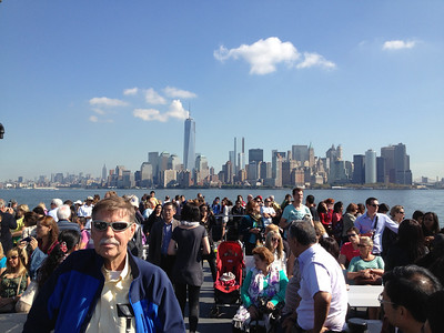 Uncie Bob Skinner on the ferry to Liberty Island with the New York City skyline in the background.