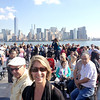 Lois Skinner on the ferry to Liberty Island with the New York City skyline in the background.
