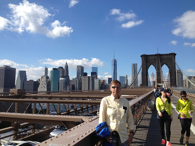 Bob Skinner walking across the Brooklyn Bridge