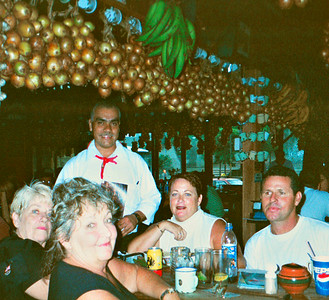 "Inviting your driver to eat with you is a GREAT way to pick their brain!  Guests Marge, Chris & Vicki from Sarasota, Florida with driver (after a LONG day of exploring) Frank Chicas enjoying a ""typico"" Costa Rican meal!"