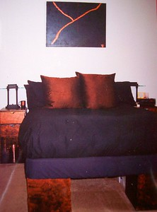 "I LOVED this bed at my SOMA St. Francis Place Apartment in San Francisco (about 1993-1996)!!  Made up of those partical board cubes painted copper & smudged with black & it was such a sensual bed with a feather mattress topper & a feather comforter & 5 feather pillows!!!  YUP that's a Vicki Original ""painting""!!!"