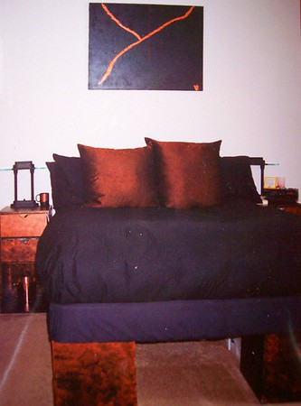 "I LOVED this bed at my SOMA St. Francis Place Apartment in San Francisco (about 1993-1996)!!  Made up of those partical board cubes painted copper & smudged with black & it was such a sensual bed with a feather mattress topper & a feather comforter & 5 feather pillows!!!<br /> <br /> YUP that's a Vicki Original ""painting""!!!"