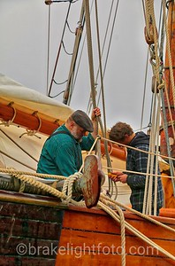 Crew working on tall ship