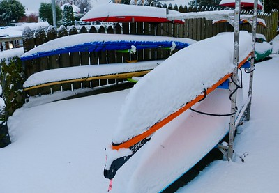 Kayaks in the Snow