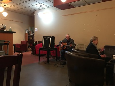 """John """"the Grocer"""" from Cook Street Village playing music at Serious Coffee."""