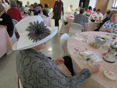 Power of Flowers Project founder and executive director Joyce Bellefeuille dressed for the tea in an elegant hat. Photo by Mary Leach