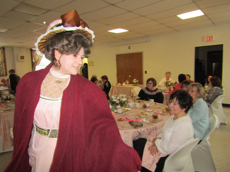 Rita Parisi, dressed as Victorian-era character Mrs. Michael Gordon, breezed into the Power of Flowers Project's tea in the Tewksbury Congregational Church. Photo by Mary Leach