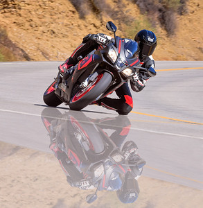 A little custom work on a great looking shot of the Aprilia and rider