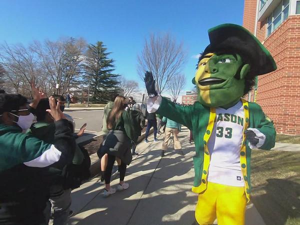 Mason Patriot mascot high during Homecoming
