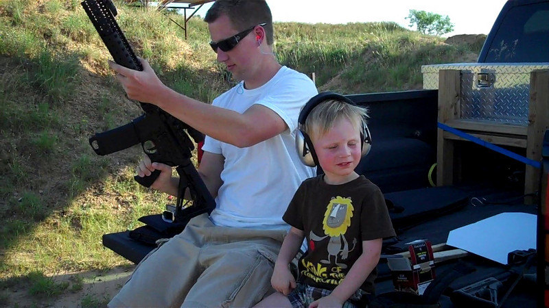 Uncle Mark and Kyle shooting the AR.