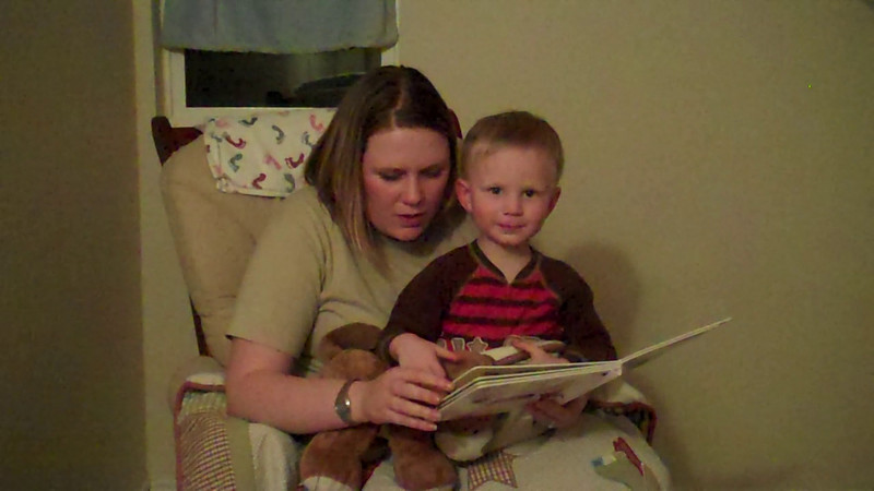 Mom reading to Kyle before bed....his nightly ritual starts at one book and always ends up being 2-3.
