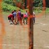 pan shot of futbol game, prayer before the start