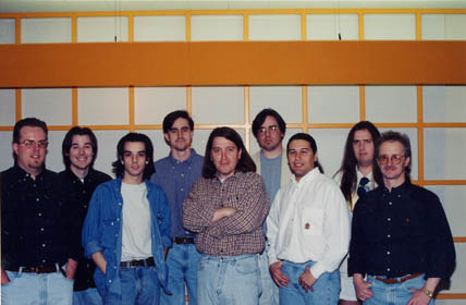 """The earliest picture taken of Ion Storm. These were the first people on the Daikatana team (left to right): Bryan Pritchard, Jerry O'Flaherty, Brian """"Whaleboy"""" Cozzens, Matt """"DaBug"""" Hooper, Peter Marquardt, Kee Kimbrell, John Romero, Shawn Green, John """"Dr. Sleep"""" Anderson."""