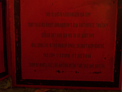 "The inside cover of the digipak in production.  It reads,""This is just a place holder for copy that tells all about John Romero's new masterpiece. This copy is also just here for you to see what type will look like in this area of space.  So don't keep reading this copy.  It's stupid.  It's just a mind dump of what I felt like writing at the time this was written.""  LOLZ!  Go Sasha! (Sasha Shor, creator of all Ion Storm's packaging and corporate identity, etc.)"