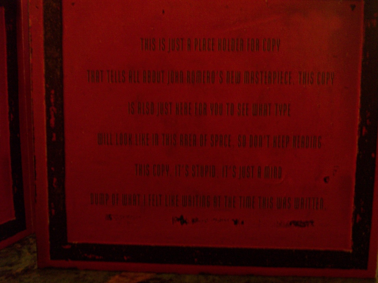 """The inside cover of the digipak in production.  It reads,""""This is just a place holder for copy that tells all about John Romero's new masterpiece. This copy is also just here for you to see what type will look like in this area of space.  So don't keep reading this copy.  It's stupid.  It's just a mind dump of what I felt like writing at the time this was written.""""  LOLZ!  Go Sasha! (Sasha Shor, creator of all Ion Storm's packaging and corporate identity, etc.)"""