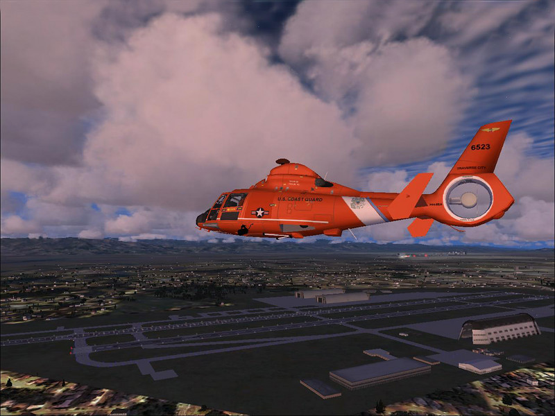 Coast Guard HH-65 Dolphin helicopter over Moffet Field, Mountain View California.