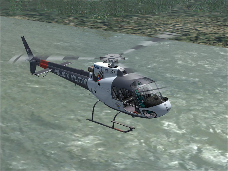 Eurocopter AS350  helicopter flying low over a river in Brazil. Screenshot form Microsoft Flight Simulator X