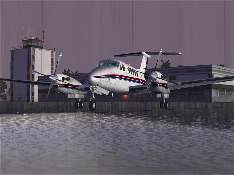 The AFG Beech King Air 300 parked on the ramp in the rain.