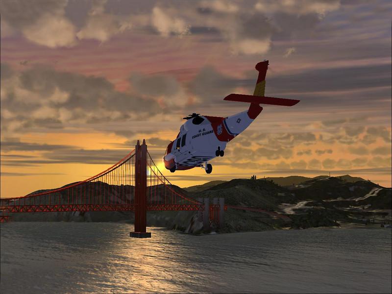 Sikorsky HH-60J JAYHAWK helicopter flying toward the Golden Gate Bridge at sunset.