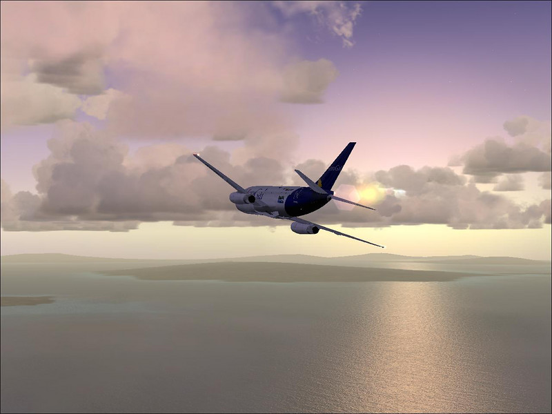 TinMouse II Boeing 737 flying off into the sunset. Screenshot from FSX