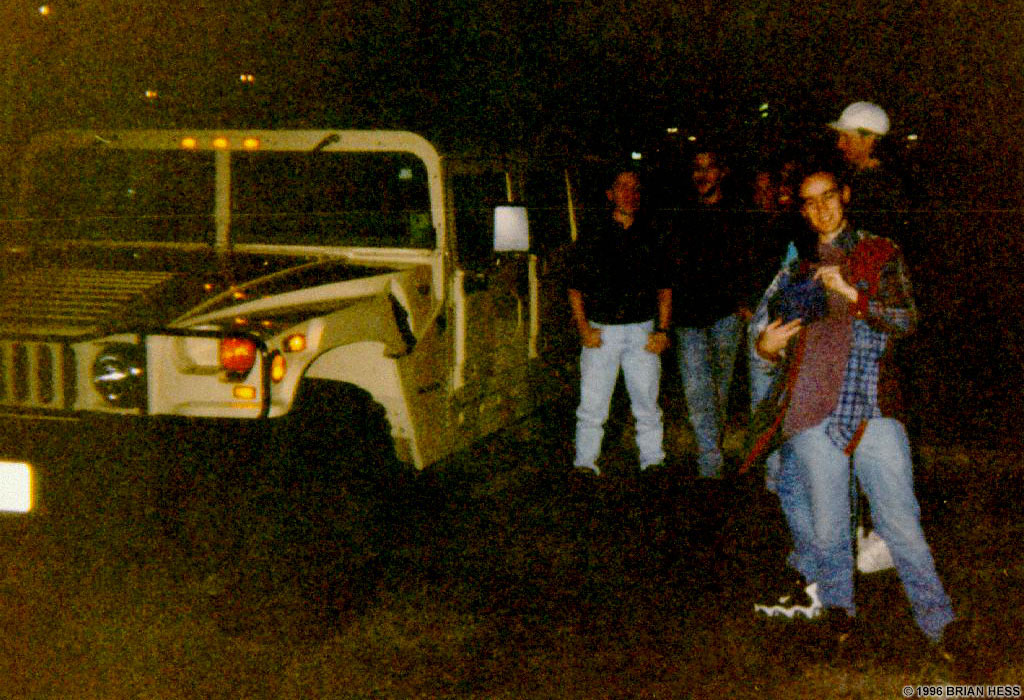 Checking out Romero's Hummer in the parking lot