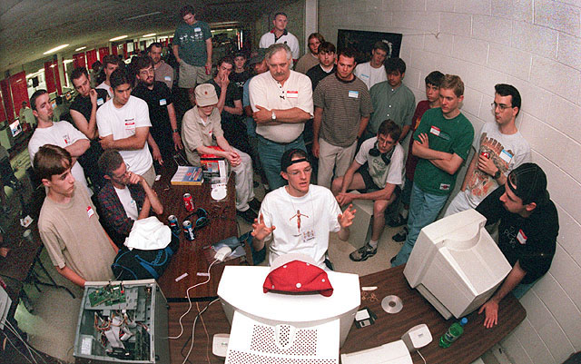 6/5/98 FOR FRIDAY EXTRA STORY BY REED: SLUG, UBERFEST: Don MacCaskill demo the soon to be released game SiN at Uberfest 98. Game developers from Outrage Entertainment, Acclaim and Ritual visited the Lan fest to hear what the hard core gamers had to say about their products. by JIM REED