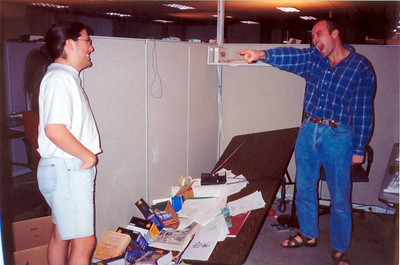 This is a picture from 1997 after a hardcore Quake1 deathmatch session with my friend Noel Stephens at Ion Storm (the 30th floor, a year before we moved up to the 55th floor).  The rule that I created (back at id Software with my friend Shawn Green) was that if you got beaten in a deathmatch your opponent could go absolutely nuts and degrade you and you had to just sit back and take it.  So after our insane deathmatching session in which Noel beat me down, I went freaknuts and grabbed my keyboard and started screaming and chopping at the legs of my computer table - and hacked at the leg until it folded up and the table fell down. Then Noel ran over and started yelling at me calling me all kinds of names and I had to just suck it down.   I subsequently did this to the table my computers were on and the entire table and computers, monitors, etc. all slid crashing to the floor.  Unfortunately I don't have a picture of that mess. :)