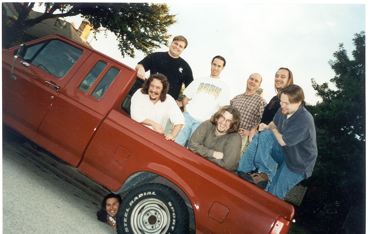 """This was an early Ritual Entertainment team picture. No room in the truck, so I got under it!  From left to right: Mark Dochtermann, Richard """"Levelord"""" Gray, Mike Hadwin , Jim Dose, Harry Miller, Rob Atkins, Tom Mustaine"""
