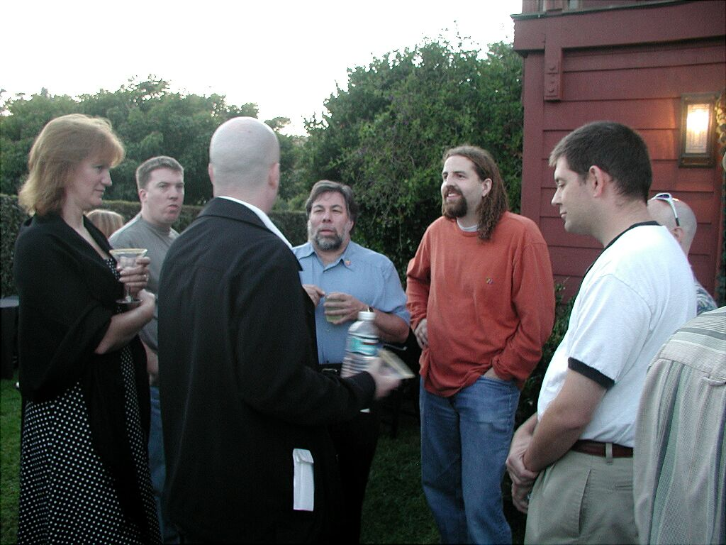 I organized the Apple II Reunion of 2004 at the house of John Garcia (owner of Novalogic, coder of Zaxxon on the Apple II) and invited many Apple II alumni.  Steve Wozniak graced us with his august presence once again and even rode up on a Segway!  To the right of Woz is Squirrel (coder at Ritual Entertainment and a great, great guy).  To the right of him is John Miles and you can barely see Lane Roathe behind him with the sunglasses on his head.  Tom Hall and his soon-to-be wife Terri are in the foreground.