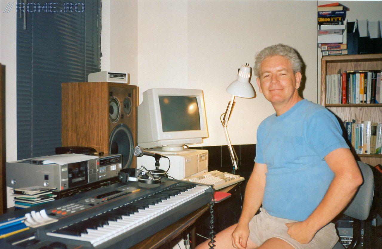 This is the great Bobby Prince, our music composer between 1991-1994.  He did the music for Commander Keen 4, 5, 6, Catacomb 3D, Wolfenstein 3D, Spear of Destiny, DOOM, DOOM II.  In this picture you can see Bobby at id's apartment office during the summer of 1992, working on the music for Wolf3D and Spear of Destiny.  This picture is probably from the month of June.  The computer he's using in the pic is a 386/33. Heh.
