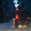 Following a tractor plowing snow on narrow forest lane 2