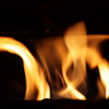 Fire burning in an iron fireplace
