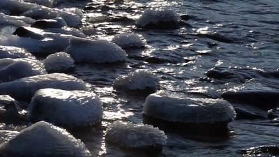 Ice-covered rocks on a beach