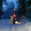 Following a tractor plowing snow on narrow forest lane 1