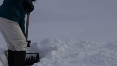 Woman showeling snow