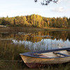 Pan over a rowing boat at a lake