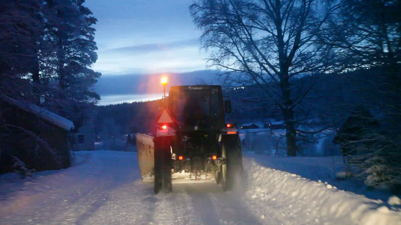 Following a tractor plowing snow on narrow forest lane 3